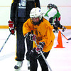Citizen photo by David Mah Prince George Cougars Brett Connolly watches Grace Barlow, 9, stick-handle at the Turcotte Stickhandling School at the Elkcentre Wednesday.