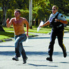 Citizen photo by David Mah Cst. Kerry Mazur chases a male on Nicholson Street. He was believed to be involved in a domestic dispute which occured early Wednesday morning. The investigation is still underway.