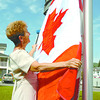 Citizen photo by David Mah Prince George Chateau manager Sharon Hatley assists maintenance manager Ron Sherb in hanging new Canadian and British Columbian flags in the front of the building.