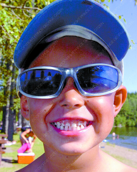 Citizen photo by David Mah Kobe Fulton, 4, made sure he wore a hat and sunglasses to protect himself from the sun at West Lake Saturday.