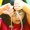 Citizen photo by Brent Braaten Olivia spooner, 7, works on her shark tooth necklace Friday at Two Rivers Gallery Summer Art Club 2008. This weeks theme was 'Shark Attack'. Children made art projects based on sharks. This was the final week for this years Summer Art Club.