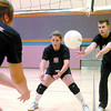 Citizen photo by David Mah Myia Stauberg, left, and Danielle Brandon work on skills with coach Spencer Reed at the Thompson Rivers University volleyball camp at the Civic Centre.
