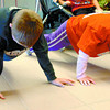 Citizen photo by David Mah Damon Giesbrecht, 9, left, and his sister Cassidy, 8, warmed up for the 1 km race by doing pushups in the Civic Centre.