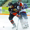 Citizen photo by Brent Braaten Cougars Parker Stanfield gets tangled up try to play the puck in front of the Edmonton Oil Kings net Saturday night at CN Centre.