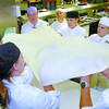 Citizen photo by David Mah College of New Caledonia Culinary Arts students stretch out a thin layer of dough to make apple struedel. Streudel was one of many desserts to be made quickley and to a chef's sandard.