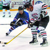 Citizen photo by David Mah Art Frenette, right, of the Prince George Mohawk Vintage keeps the puck away from Roar Hegge of the Peace River Freedom 55 Oldtimers in the 55 - 60 year-old class in the Seniors hockey at the Coliseum Wednesday.