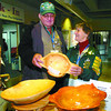 Citizen photo by David Mah Everett Rookes, left, from Sparwood, and Evelyn Koopmans, from Telkwa, who are competing in horsehoes stopped at the Games Village in the Kin Centre to look at Scullee's Hand Carved bowls and canes.
