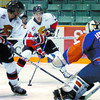 Citizen photo by Brent Braaten Cougars Parker Stanfield gets ready to take a shot on Kamloops goalie Justin Leclerc.