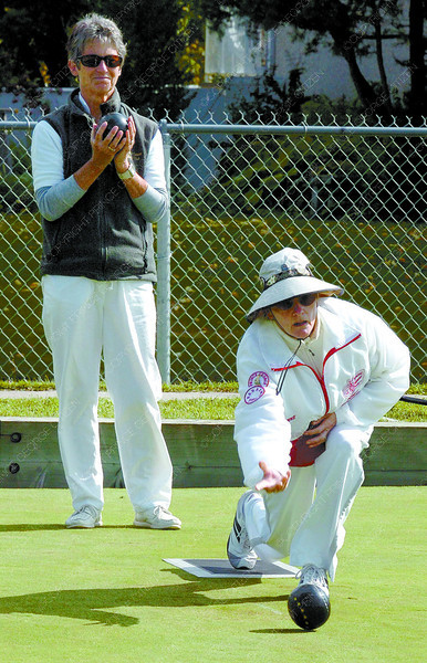 Citizen photo by David Mah Sandra Mitchell, from Parksville, left, and Anne Bastelaere, from Sydney compete in the Lawn Bowling at Watrous Park in the Seniors Games Friday.