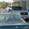 Citizen photo by Brent Braaten Vehicles line-up for gas at the 5th and Central Esso Friday afternoon. Drivers were trying to get gas at $136.9 a litre at the pumps befor it went up to what the sign said of $147.9 a litre