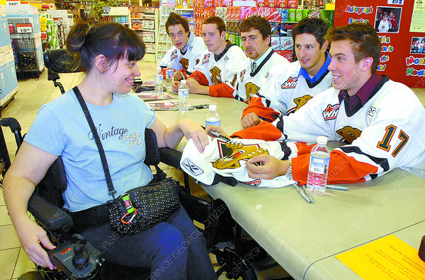 Citizen photo by David Mah Kathy Gunn was pleased to have her jersey signed by Prince George Cougars Justin Maylan, Corey Tyrell, Colin Scherger, Trevor Bauer, and Ryan Kowalski at the Big Brothers Big Sisters Cougar Autograph fundraiser at Canadian Tire Saturday.