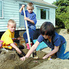 Citizen photo by David Mah Phillip Rossetti, 5, left, his brother Jaeden, 7, and sister Jordanna, 9, had their own mountain of dirt to play on because their neighbor on Juniper Street was doing some basement wall repair.