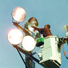 Citizen photo by Brent Braaten Scott Smith an electrician with Centre City Electric changes a 1500 watt bulb on one of the light towers at Rotary Soccer Fields on Ospika Blvd Wednesday morning.