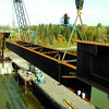 Citizen photo by Brent Braaten SureSpan Construction placed the longest piece of steel on the new Simon Fraser Bridge project Wednesday morning. The steel section that the lifted weighed 216,000 lbs. Two cranes siimultaneously raised it into place.