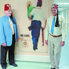 Citizen photo by Brent Braaten Shrine Potentate Lorne Donalds and Shriner Myron Sambad staband next to the picture in the peds ward for 25 years of support to PGRH by the Shriners.