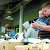 Citizen photo by Brent Braaten Craig Morrison and Corbin Morrison, 9 months look over the books at the Kiwanis Annual Book Sale at the College Heights Save-On.