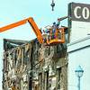 Citizen photo by Brent Braaten The demolition of the Columbus Hotel continued Sunday afternoon.