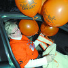 Citizen photo by Brent Braaten Helen Domshy trys to get balloons in her car befor heading out.
