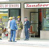 Citizen photo by Brent Braaten City of Prince George Fire Department and Terasen Gas attended bussinerss on 5th Avenue in the 1000 block Thursday afternoon. There was a high level of natural gas in the bussinesses and they were evacuated. The source of the gas was found and the building ventilated and staff was allowed to return.