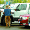Citizen photo by David Mah Prince George Motors salesman Dextor Tabora, left, chats with customer Tim Harley while his wife Debbie tries out the F-350 at the Liquidation Sale at the CN Centre parking lot. Wood Wheaton, Schultz Pontiac, Honda, and Prince George Motors will be there this weekend.