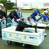 Citizen photo by David Mah Bath tub racers, Martyne Todd, left, with Andrew Sheret LTD, Christine Wall, Habitat for Humanity President, Ken turner, with Bandstra trucking, and Al Forsythe, with Eagle Plumbing, speed off in the 2008 Habitat for Humanity Bathtub Race held at Bartle and Gibson on Eastern Street. Entry Fees, sponsorships and donations went to Habitat for Humanity.