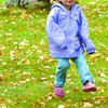 Citizen photo by Brent Braaten Autumn Ordzuk, 3, does not let the rain dampen her fun at Connaught Hill Park Thursday afternoon.