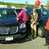 Citizen photo by David Mah Fred and Marcia Brown and Ernie Nahachewski, from Schultz Pontiac, chat about the Pontiac Montana van at the Liquidation Sale at the CN Centre parking lot. Wood Wheaton, Schultz Pontiac, Honda, and Prince George Motors were there on the weekend.