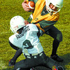 Citizen photo by David Mah Andrew Cryderman, right, is hauled down by Mitch Schulz, in the PG Minor Football Association Peewee white vs Peewee gold game Saturday.