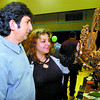 Citizen photo by David Mah Dionisis Kovras, left, and Christine Schmelzel look at their purchase at the Mennonite Fall Fair held at the Civic Centre Saturday and Sunday. The popular fair filled the Civic Centre.