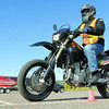 Citizen photo by Brent Braaten Chuck Leblanc rides through the cones while being watched by instructor Jack Giannisis with PG Learn to Ride at the multiplex parking lot Monday morning. Riders were preparing for the ICBC MST test that alolows riders to ride on the road to prepare for the road test.