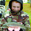 Citizen photo by David Mah Jordan Law, 10, admires his trout he is taking home to eat. The fish came from the Spruce City Wildlife hatchery.