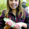 Citizen photo by David Mah Kylie Shepert, 11, holds onto her freshly-caught rainbow trout she caught in the fish pond at Rivers Day in Fort George Park. The fish came from the Spruce City Wildlife hatchery.