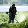 Citizen photo by Brent Braaten Joe Snyder with DART team cuts down the weeds along Highway 97 South by the Simon Fraser Bridge Monday morning.