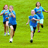 Citizen photo by David Mah College Heights Elementary students Courtney Hirst-Smith, left, Dayna Hamilton, Shannon Glazier, Danae Nelles, all 12, finished in a pack at the Rainbow Classic Cross-Country Run put on by Spruceland Elementary School at Rainbow Park.