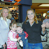 Citizen photo by Brent Braaten Shop Free winner. From left to right Hugh Nicholson, Publisher Prince George Citizen, Suzan Gardner, Advertising Consultant Prince George Citizen, winner Patricia Wheeler with Taylor , 2, and Tyler 5 months and Rick Nelson Pince Centre Mall General Manager.