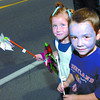 Citizen photo by Brent Braaten Sayler Ryckman, 6, and Joshua Leboe, 6, with their pinwheels along the walk.