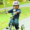 Citizen photo by Brent Braaten Kyiro Roberts, 4, lets it all hang-out as he rides his trike along a path in Fort George Park Friday morning.
