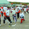 Citizen photo by Brent Braaten Cougars and fans enjoy several games of ball hockey in the CN Centre parking lot Sunday afternoon. The ball hockey game was part of the Citizen promotion of 'Meet the Pack'.