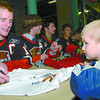 Citizen photo by Brent Braaten Liam Magrath, 3, right gets his shirt signed by Dana Tyrell and the rest of the Cougars during an autograph session after Saturdays game, partof the Citizen's Meet the Pack night.