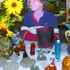 Citizen photo by Brent Braaten Bill Palmer 'the wazard of vase with antique vases for sale at the 18th annual Antiques and Collectibles Fair at the Roll-a-dome Saturday. The two day event had over 60 vendors from throuh-out the provence selling their wears. The event is a fundraiser for the South Bowl Community association.