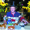 Citizen photo by Brent Braaten Bill Palmer 'the wazard of vase' with antique vases for sale at the 18th annual Antiques and Collectibles Fair at the Roll-a-dome Saturday. The two day event had over 60 vendors from throuh-out the provence selling their wears. The event is a fundraiser for the South Bowl Community association.
