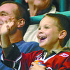 Citizen photo by Brent Braaten Matyas Mocilac, 3, has a big smile on his face as he see's himslf on the screen on the score clock during the Cougars game Satuday evening aat CN Centre.