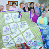 Citizen photo by Brent Braaten St. Michael's quilters group, which have been meeting every Thursday for over 30 years, hold up the raffle quilt that won a first place at this years PGX. The group also was working on items for the Victoria Street Market on Saturday October 5th from 10:00-3:00 pm at St Michael and all Angels Church. The sale will have bake table, Christmas Crafts, Quilting and Sewing, Kids Toys and Games Greeting cards, woodwork crafts and a thrift store.