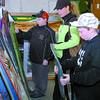 Citizen photo by David Mah Dallas Bellamy, 11, left, his mom Donna, and brother Cody, 14, checked out the snowboards at the Prince George Alpine Ski Club Ski Swap held at NR Board and Ski Saturday.