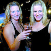 Citizen photo by David Mah Heather Hausot, left, Renee Richard, and 400 others attended Theatre North West's Wine Festival at the Exploration Place Saturday night. There were 100 wines to sample at the fundraiser.