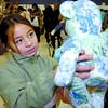 Citizen photo by David Mah Kiana Gagnon, 9, took a close look at Adelle Furgason's handmade Teddy Bears at the DP Todd Craft Fair Saturday.