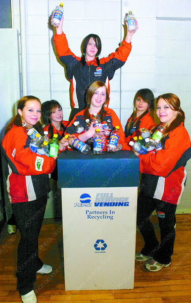 Citizen photo by David Mah Ice Girls left - Janelle Hamel, 15, Sarah Stratton, 14, Breanna Foisy, 14, Crystal Chapman, 14, (above), Espe Basnett, 14, and Nicole Dubois, 15, have initiate a recycle program at the Prince George Coliseum. The cheerleaders recycle at the end of each Spruce Kings game by collecting bottles with 4 boxes donated by Pepsi.