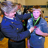 Citizen photo by David Mah RCMP Auxilliary Cst. Lisa Striker presents Heather Park Grade 6 BRAVE graduate Caleb Lindstrom, 11, and 186 others students with a gift. This is the 3rd grad class at Heather Park Middle School.