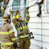 Citizen photo by David Mah Prince George Firefighters remove the hydro meter at 2707 Merritt Road to check the walls for fire after an electrical problem started a fire inside. Two pedestrians spotted the fire and reported it at 2:30 Thursday afternoon.