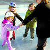 Citizen photo by David Mah Morgan Case, 3, left, Taber Metz, 6, Hannah Case, 5, and Jody Case (who was teaching), were learning to skate in a circle Saturday at the Civic Centre Plaza.